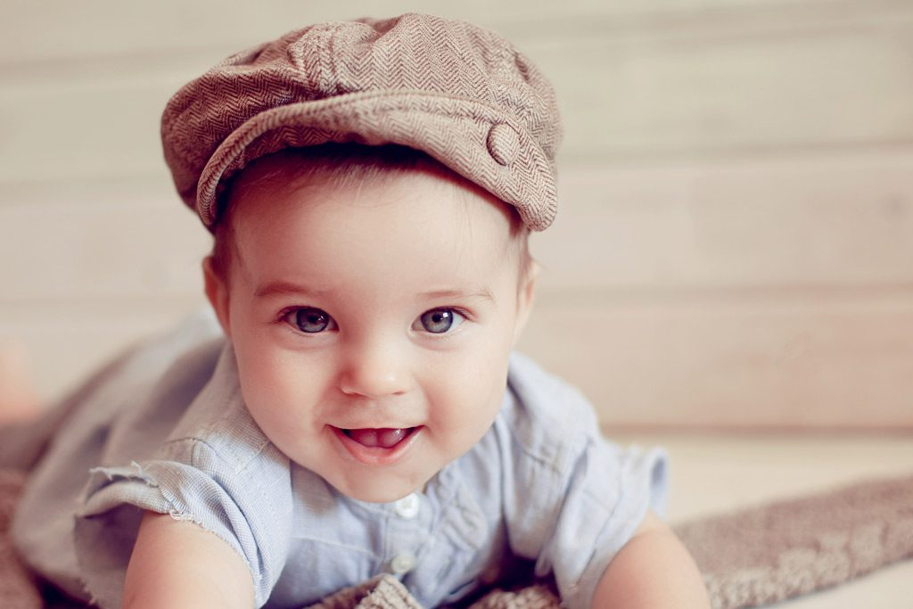 Baby boy in old-fashioned cap