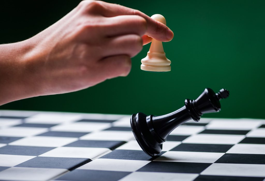Photo of chess king falling to pawn