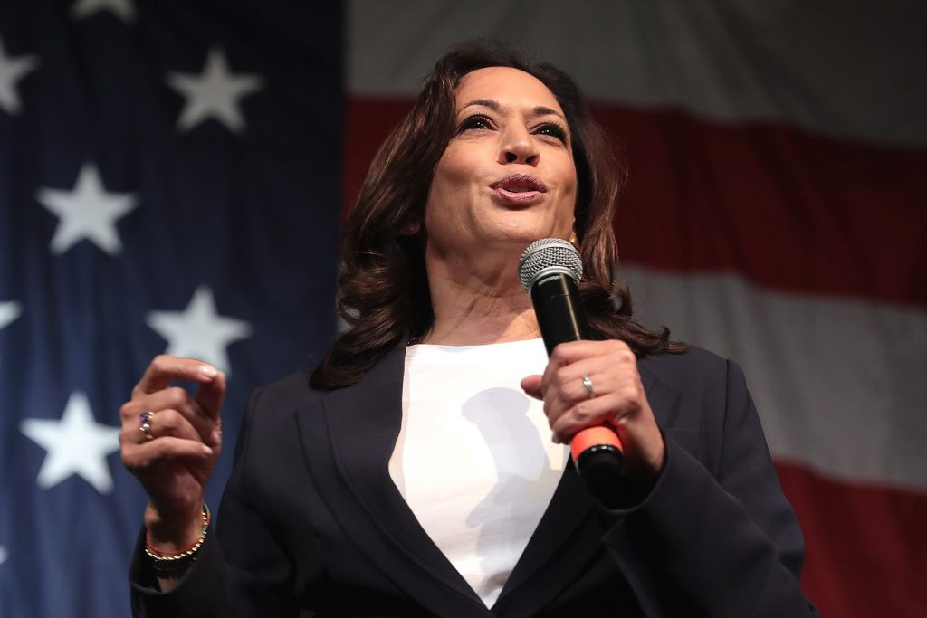 Photo of Kamala Harris in front of a US flag